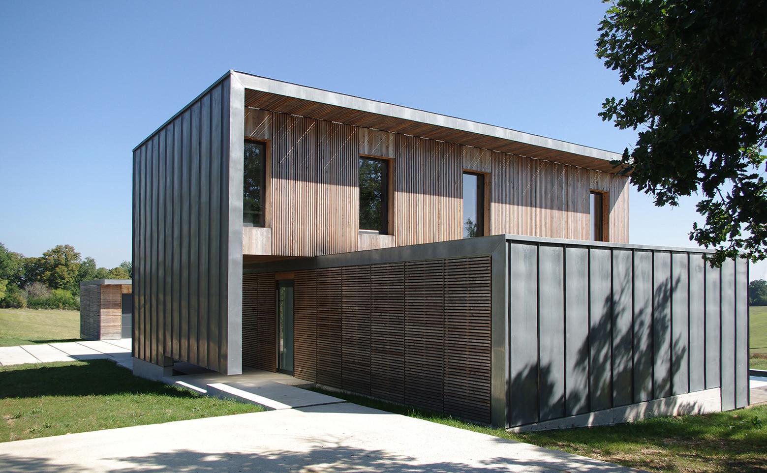 548faf3fe58eced8d00000bc_maison-l-estelle-fran-ois-primault-architecte_mox_141002_exterieur__-11-