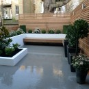 smooth-grey-paving-white-walls-flaoting-bench-modern-london-garden-design-idea