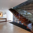 Wooden-and-Glass-Staircase-at-Modern-Home-Design-with-Central-Backyard-for-Interior-Space