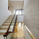 interior-modern-half-turn-staircase-with-glass-railing-and-wooden-handrails-glass-stair-railing