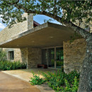 cool-modern-house-in-cedar-hill-with-stacked-stone-wall-combined-with-cantilever-concrete-canopy-and-glass-door-591x393