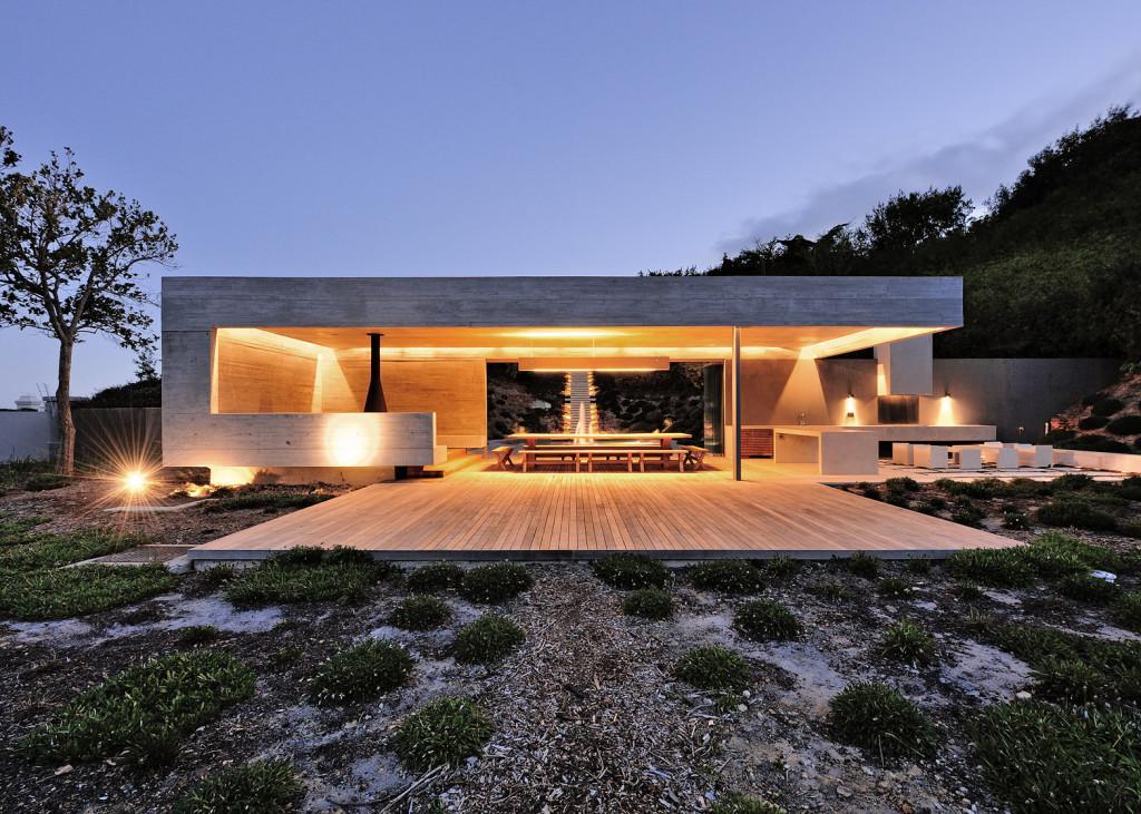 Concrete garden pavilion metropolis for Concrete home contractors