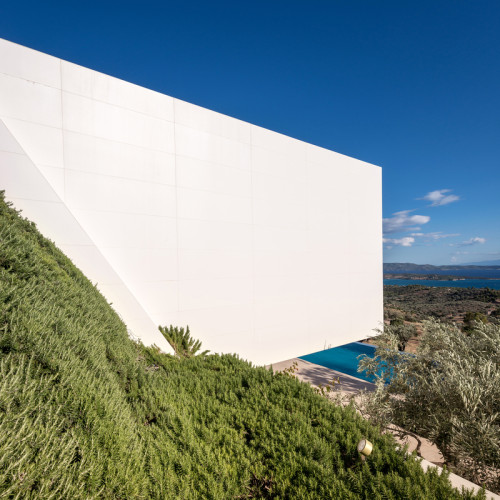 Exterior view of TRIF House in Porto Heli Greece designed by Sergey Fedotov, with frameless sliding doors by Sky-Frame AG