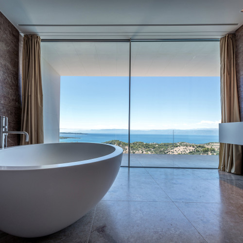Interior view of TRIF House in Porto Heli Greece designed by Sergey Fedotov, with frameless sliding doors by Sky-Frame AG